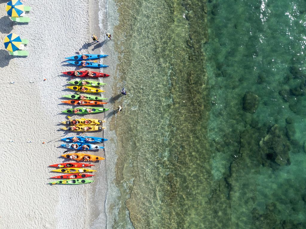Active holiday on the beach of the Greek island Skopelos: kayaks at Milia Beach, drone photo