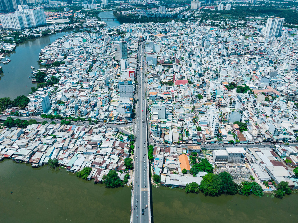 Aerial Drone Photo of a Bridge over Saigon River leading into District 8 with many Buildings in Ho Chi Minh City