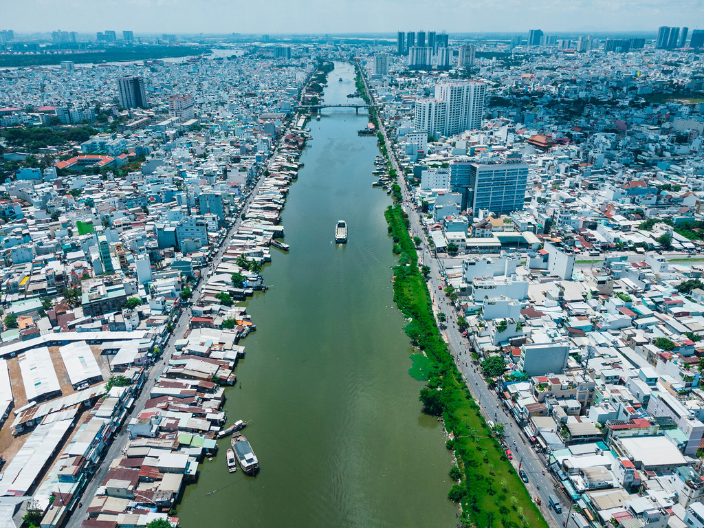 Aerial Drone Photo of Boats on Saigon River between District 4 and District 7 going towards a Bridge in Ho Chi Minh City, Vietnam