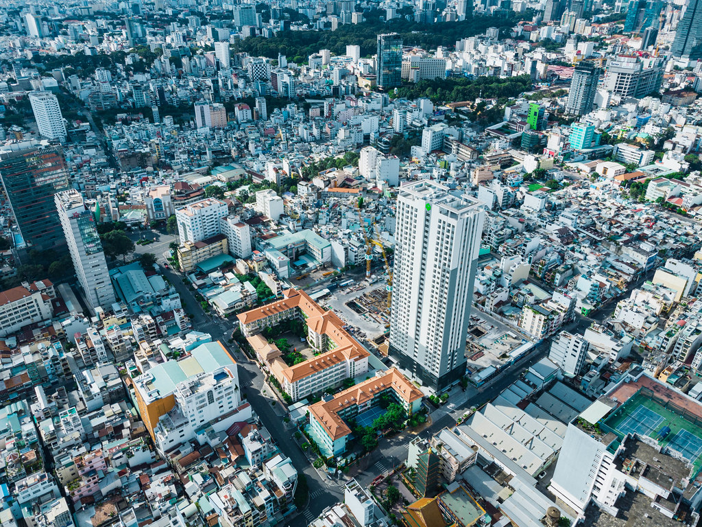 Aerial Drone Photo of District 1 of Ho Chi Minh City, Vietnam with Buidlings, Constructions and no Traffic due to a Lockdown