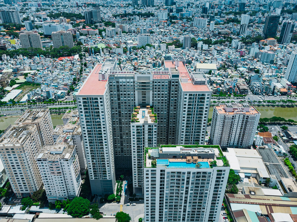 Aerial Drone Photo of Gold View Apartment Building with Rooftop Swimming Pool and Hangout Area for Residents at Saigon River in District 4 in Ho Chi Minh City, Vietnam