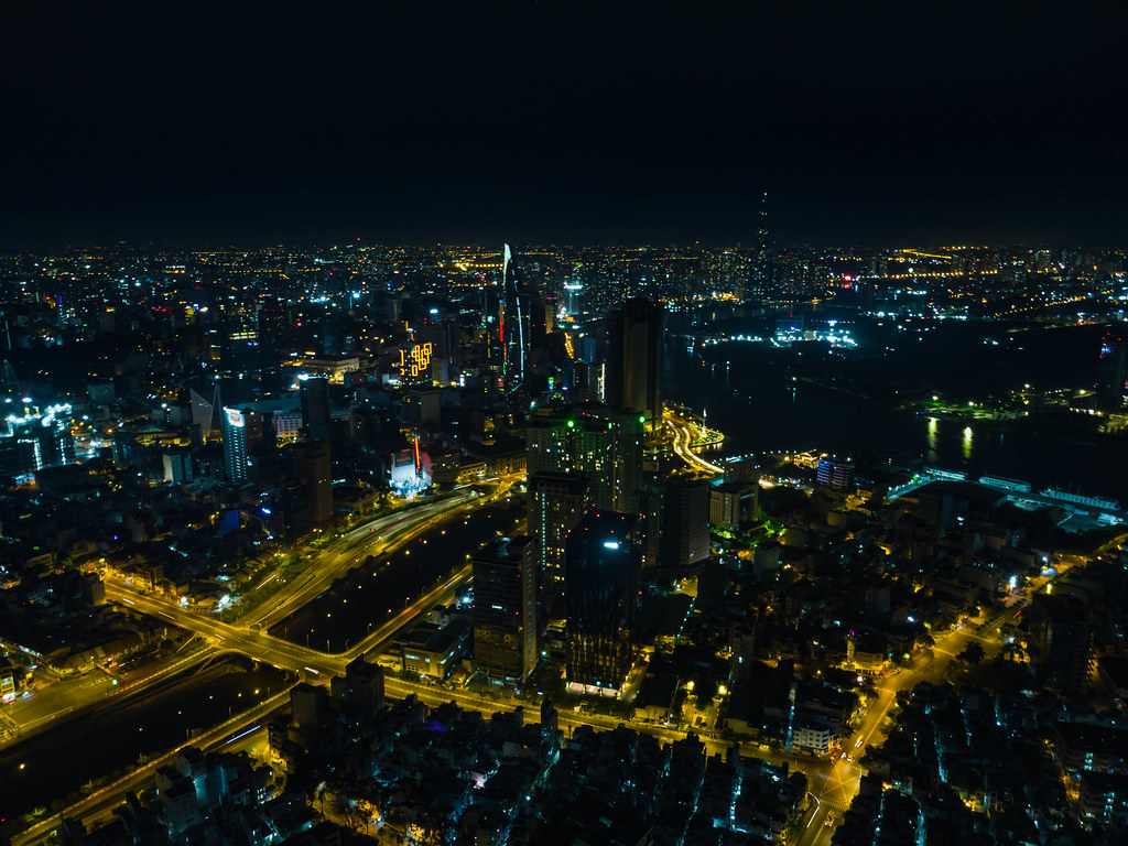 Aerial Drone Photo of several Districts of Ho Chi Minh City, Vietnam with Skyscrapers such as Bitexco Financial Tower and Landmark 81