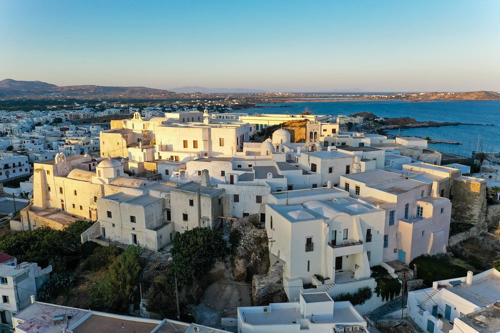 Aerial shot of the city centre of Chora, capital of the Greek island of Naxos, with typical white buildings