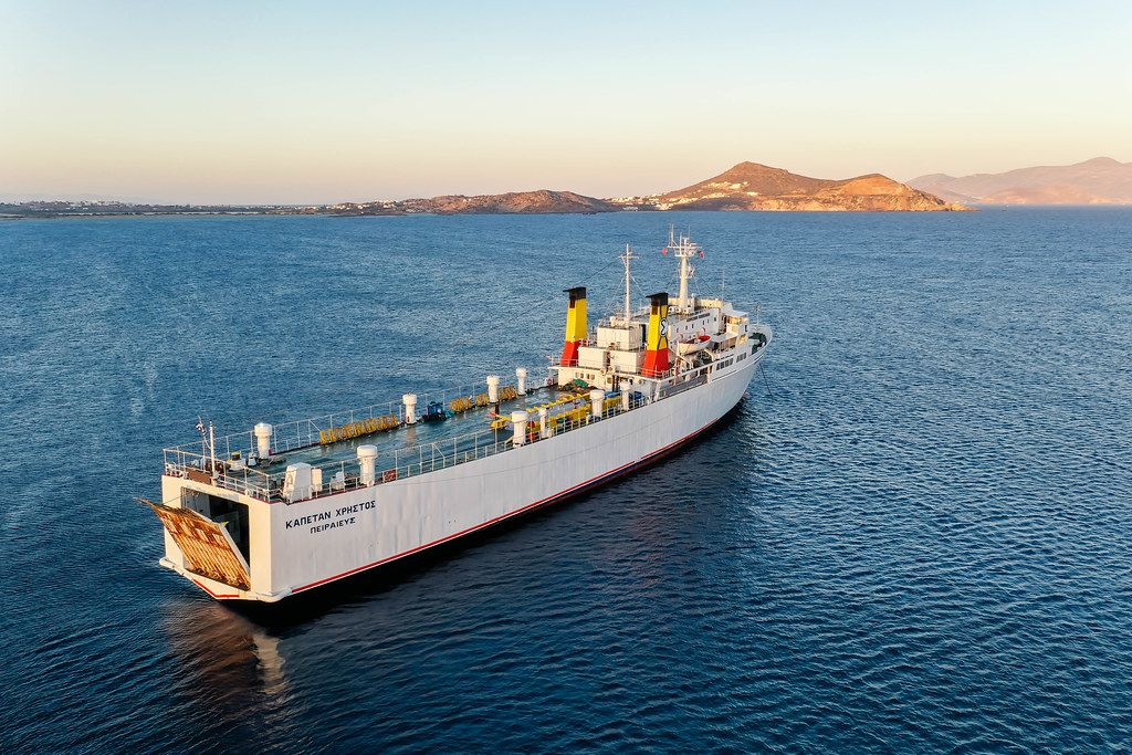 Aerial shot of the Greek cargo ship Kapetan Christos departing from the harbour of the island Naxos