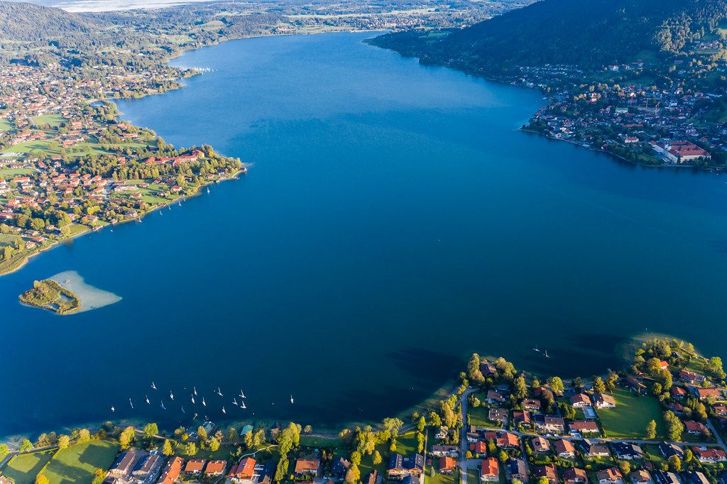 Aerial view encompassing much of the Tegernsee lake in Bavaria with the towns on its shores