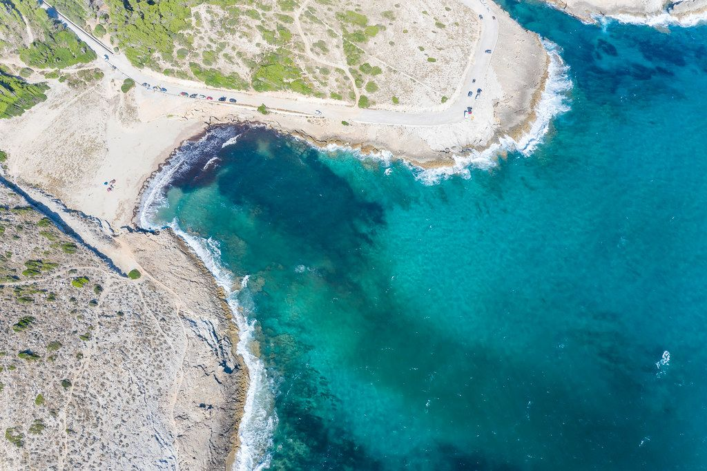 Aerial view of beach with shallow waters, fine sand and scanty vegetation. Cala Mitjana, Artà, Mallorca