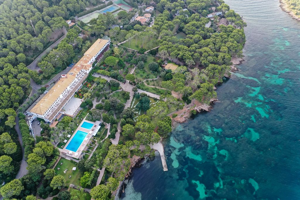 Aerial view of luxury hotel Formentor with pool at Cala Pi de la Posada, Port de Pollença, Majorca