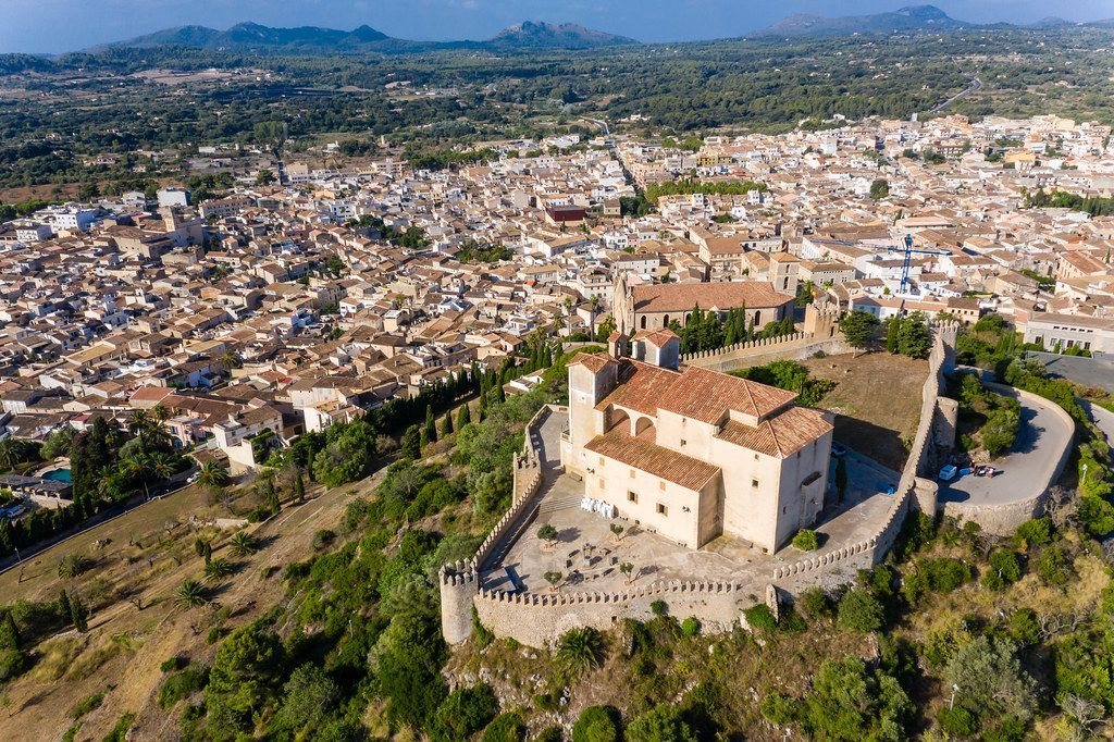 Aerial view of the medieval fortress and sanctuary of Sant Salvador overlooking the town of Artà, Majorca
