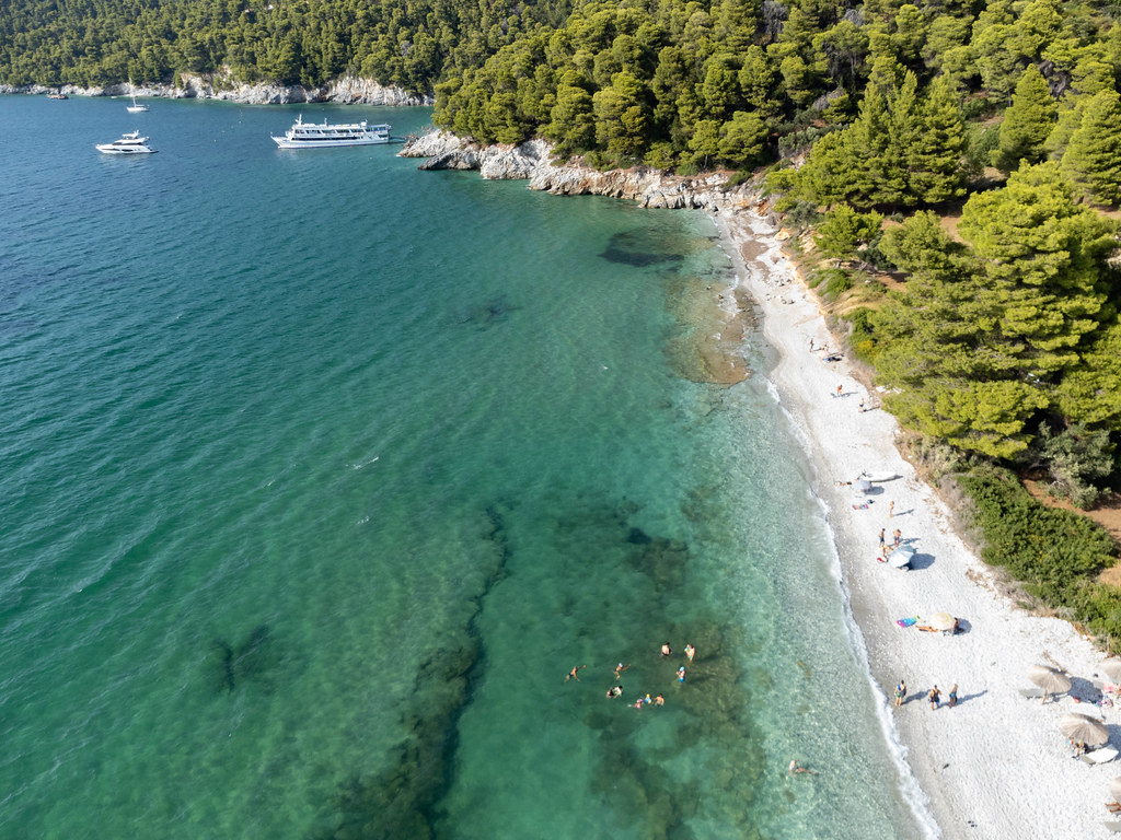 Aerial view of uncrowded Milia Beach on Skopelos: summer holiday 2021 on a Greek island