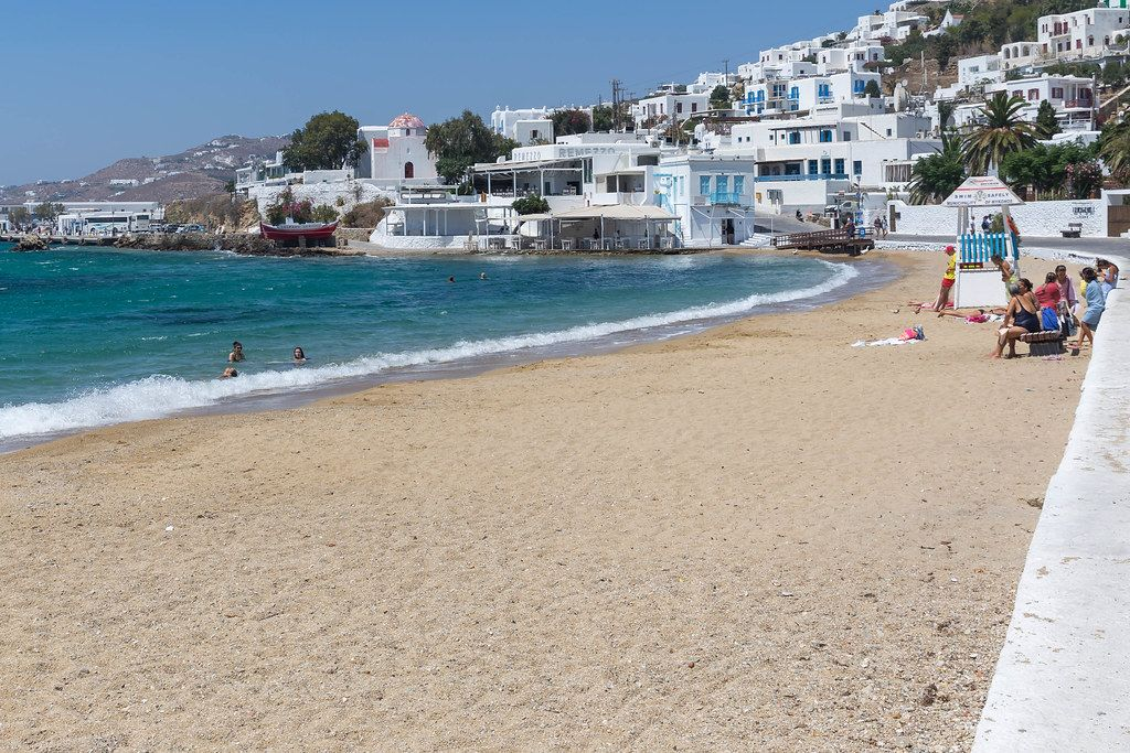 Agia Anna beach in Chora, main town of Mykonos, with few people swimming and no beach umbrellas