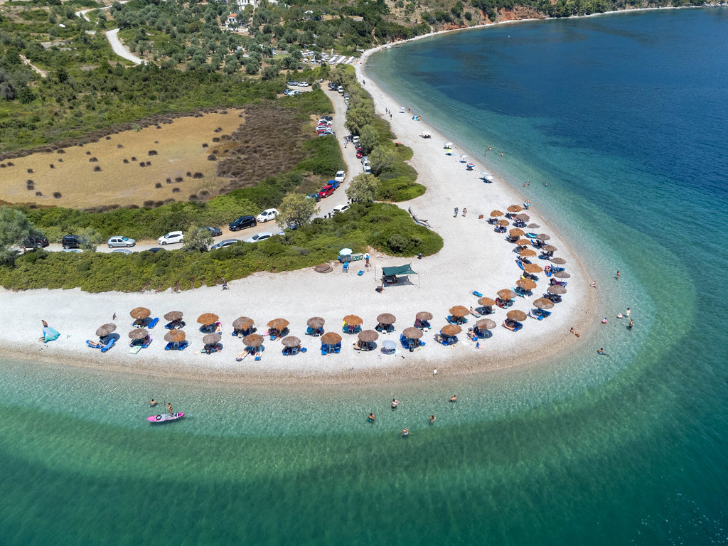 Agios Dimitrios beach on Alonissos with its characteristic horseshoe shape and turquoise-blue waters