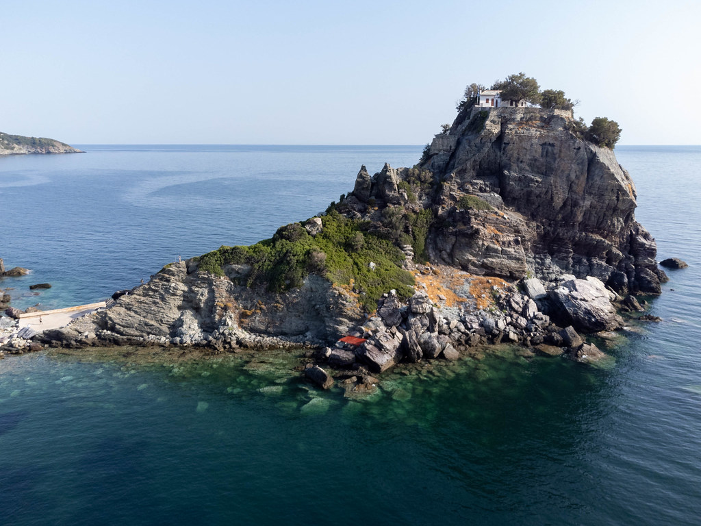 Agios Ioannis chapel and monastery surrounded by the sea on the northern side of Skopelos, Greece