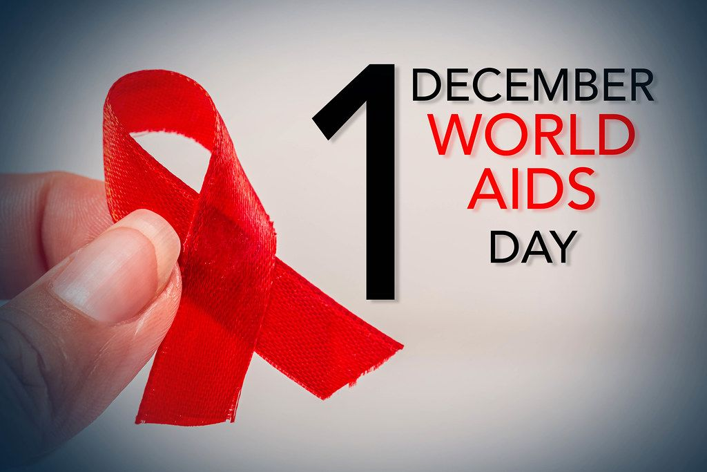Aids red ribbon on woman