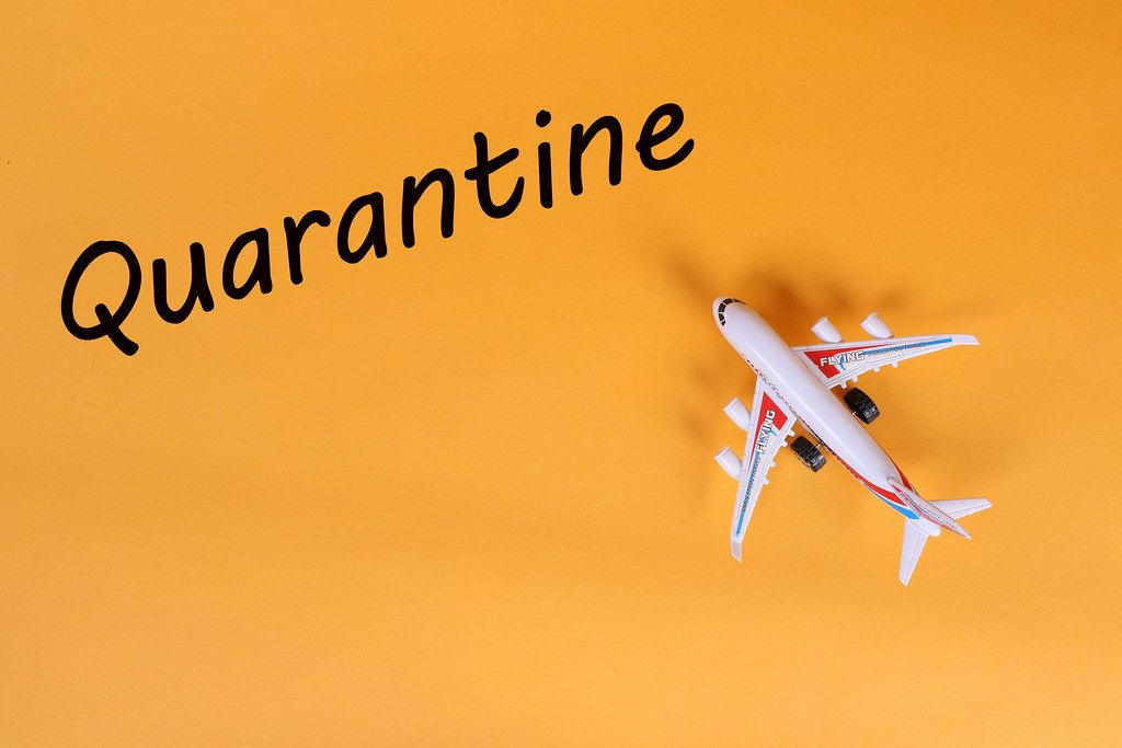 Airplane with Quarantine text on orange background