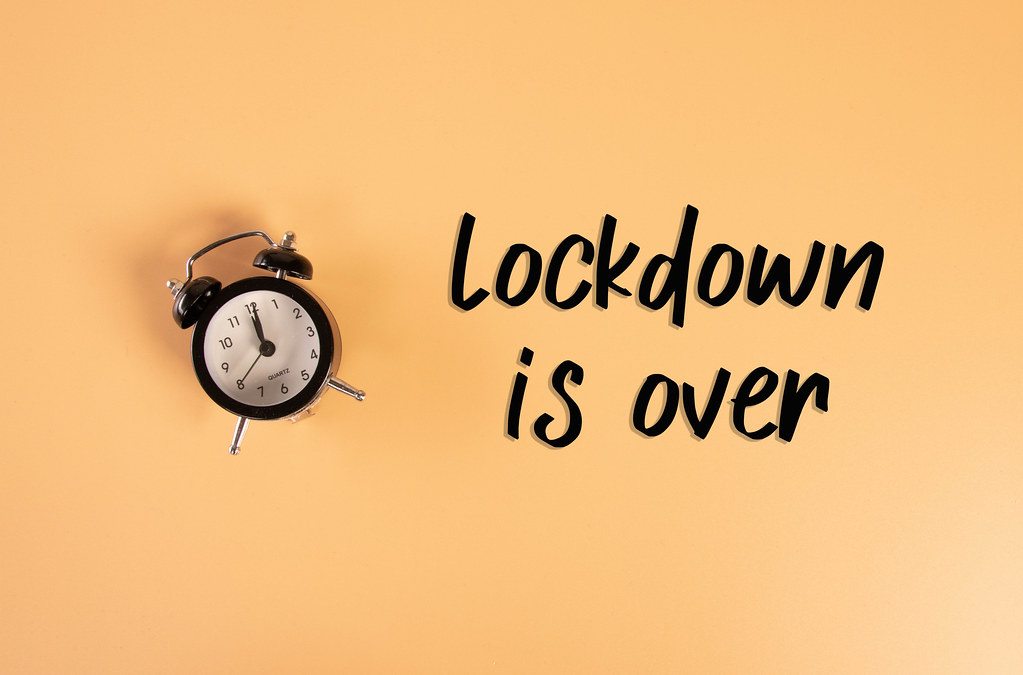 Alarm clock with Lockdown is over text on orange background