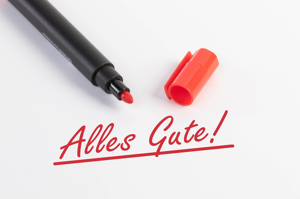Alles Gute! text with red marker pen