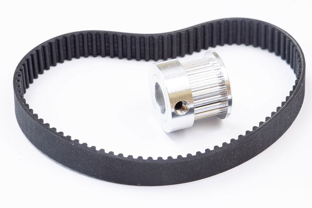 Aluminum pulley with Timing belt above white background