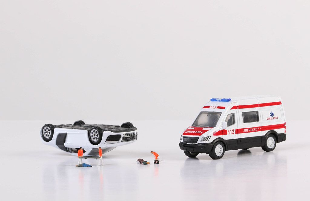 Ambulance car, paramedics and crashed car on white background