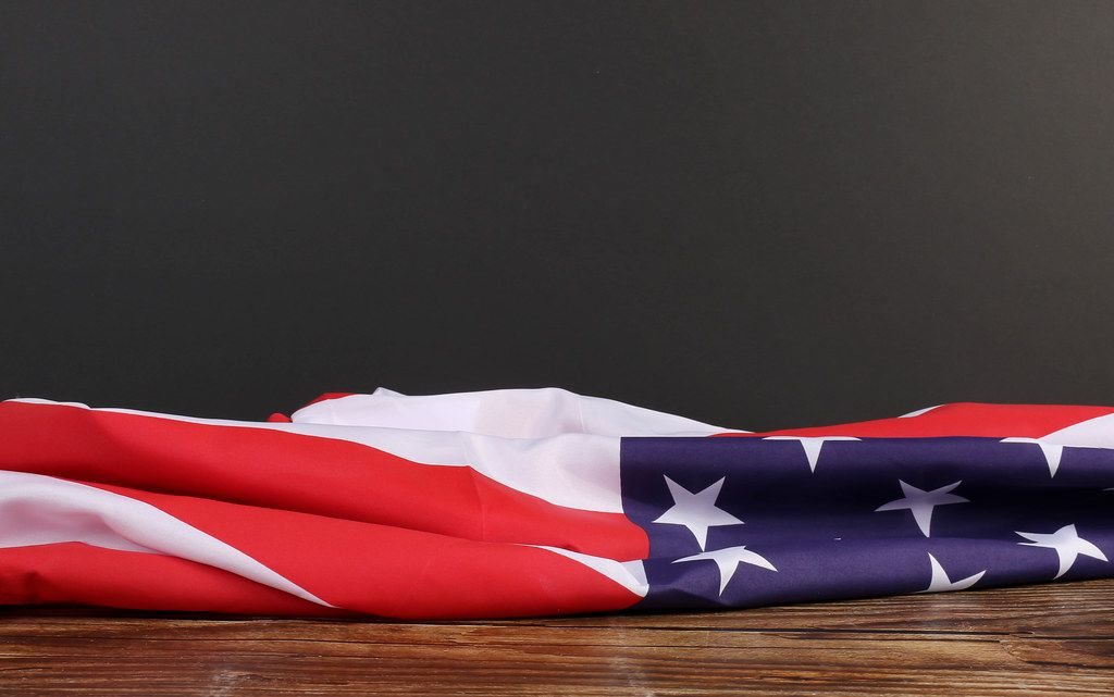 American flag on wooden table