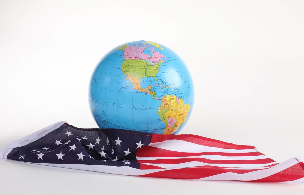 American flag with globe on white background