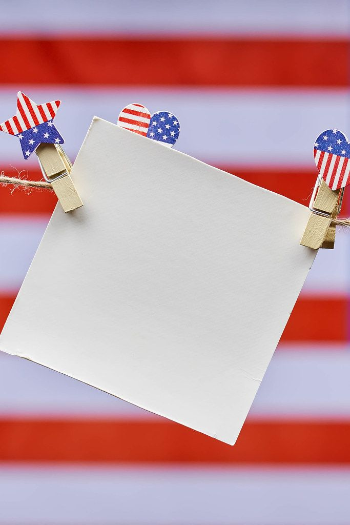 An empty card hanging over the American flag on the background