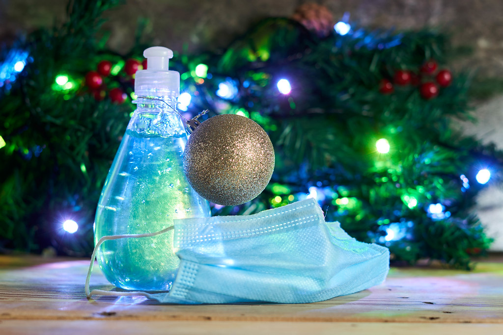 Antiseptic disinfectant gel, medical face mask and Christmas decorations
