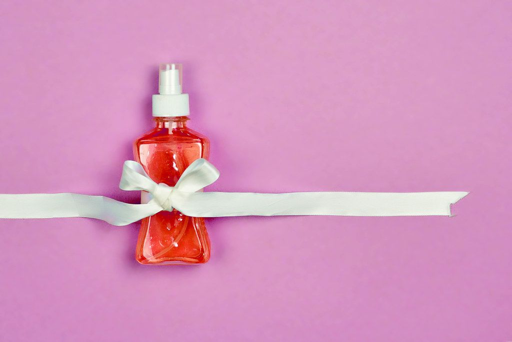 Antiseptic gel bottle decorated with ribbon