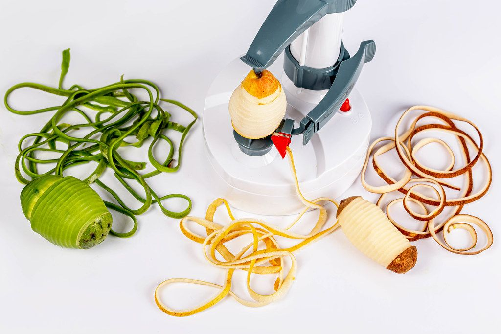 Apparatus for purifying peel with fresh fruits and vegetables on a white background