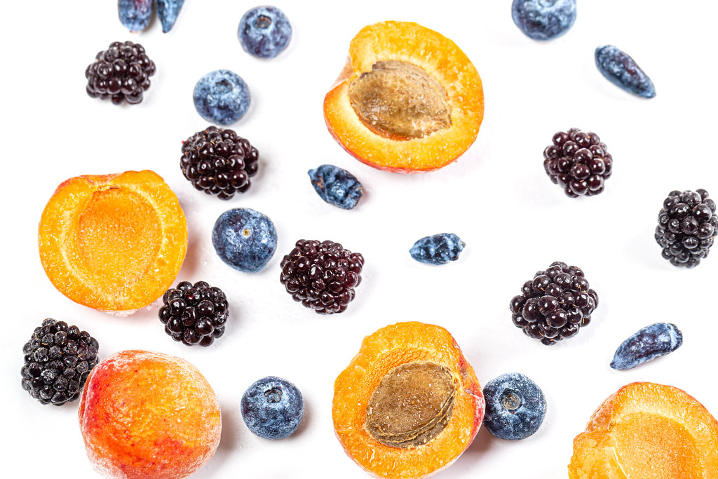 Apricot, blackberry, honeysuckle and blueberry on white
