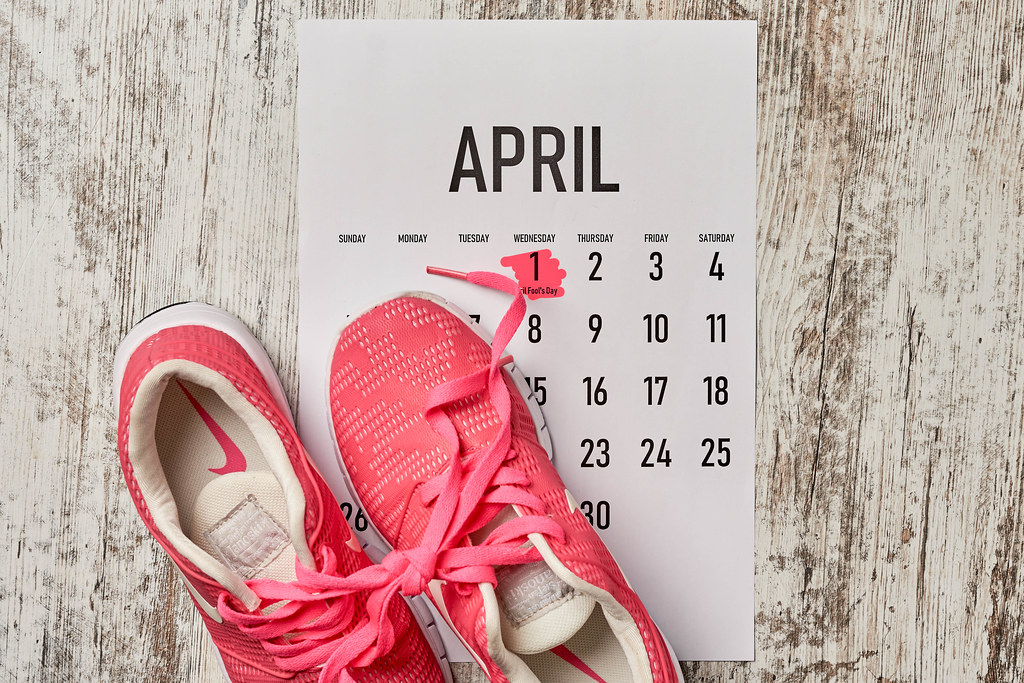 April fool's day - shoelaces tied together on wooden background