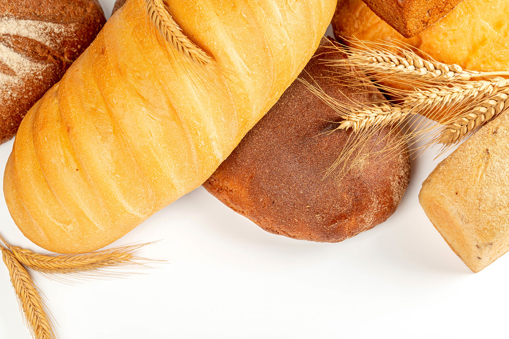 Assorted breads with spikelets on a white background
