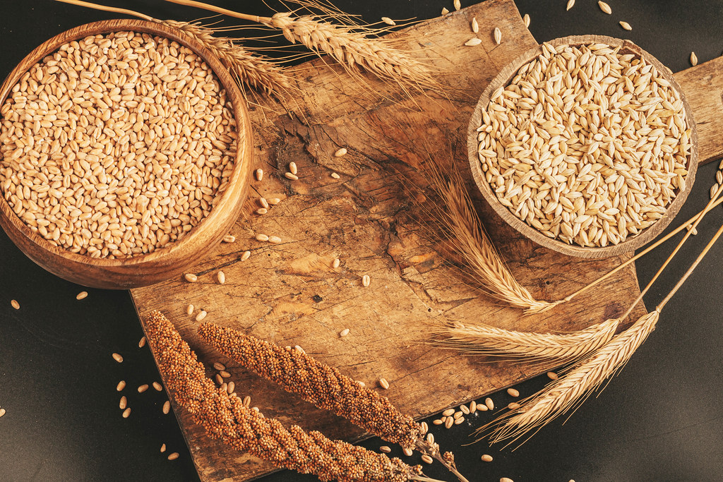 Assortment of assorted spikelets and grain in wooden bowls