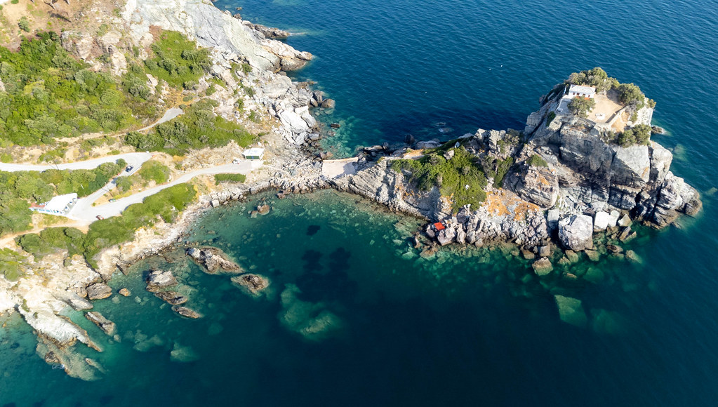 Attractions on Skopelos: the monastery and church on the rock formation next to Agios Ioannis beach