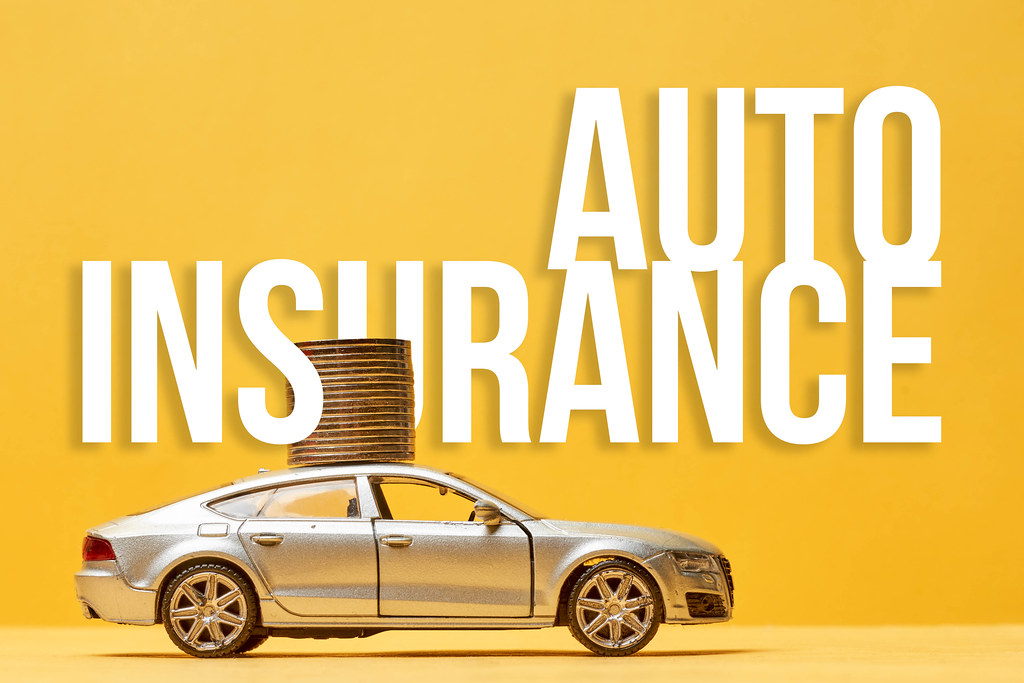 Auto insurance - toy car with a stack of coins