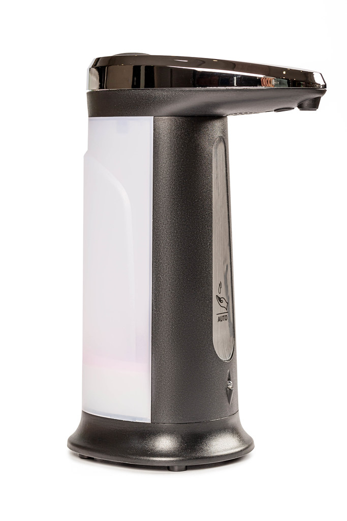 Automatic soap dispenser on white background
