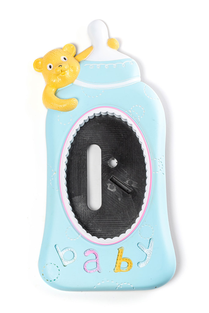 Baby photo frame in the shape of a baby bottle