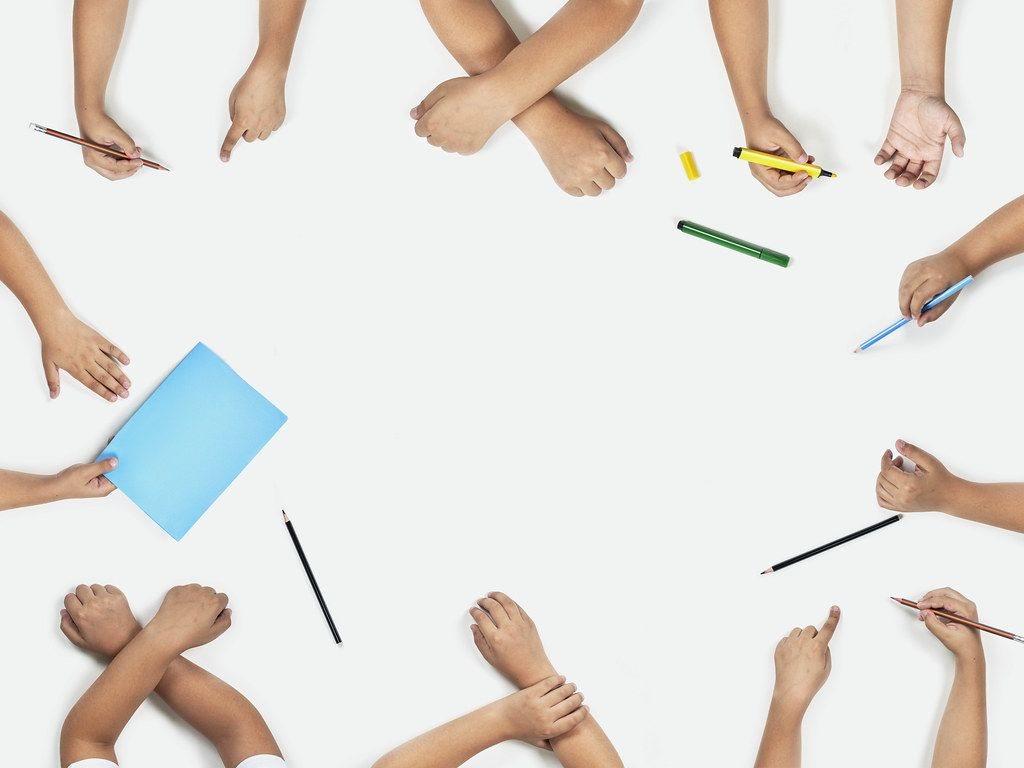 Back to school concept. Set of pupil hands. Top view