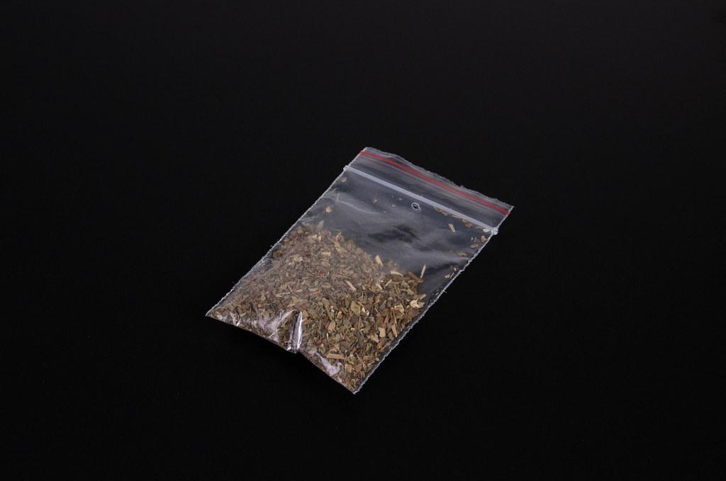 Bag with marijuana on black background