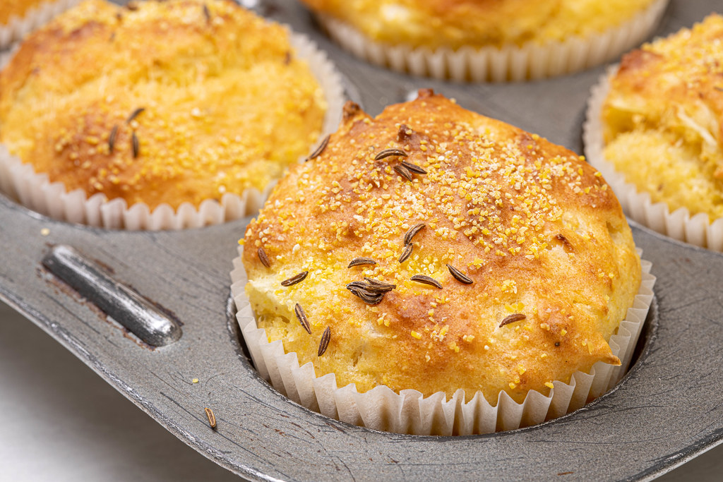 Baked Cornbread Muffins with Cheese in the cupcake papers