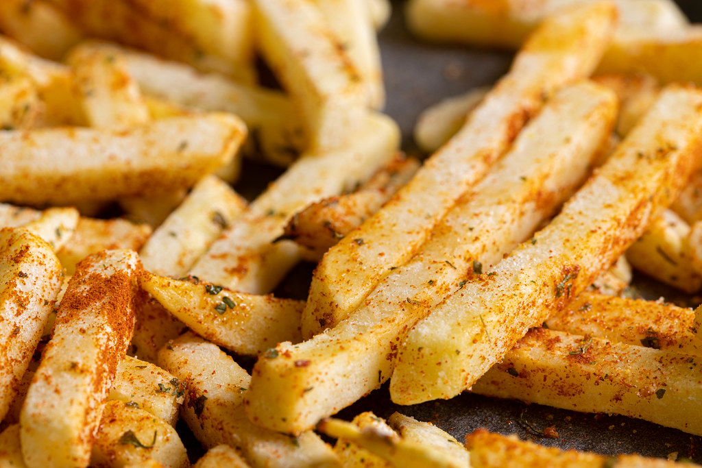 Baked French Fries with chilly spices served on the baking tray