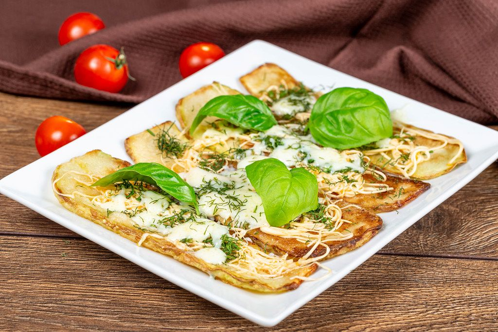 Baked zucchini with cheese and herbs