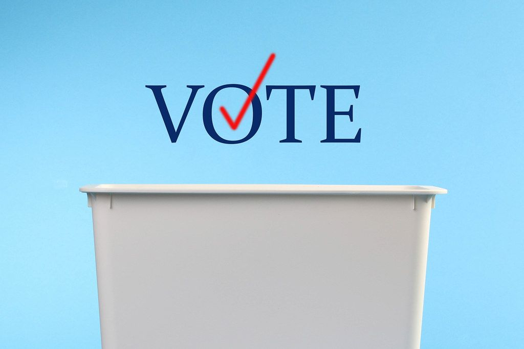 Ballot box with Vote text on blue background
