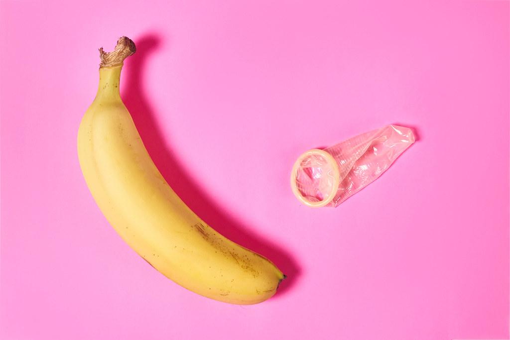 Banana and condom - erotic concept