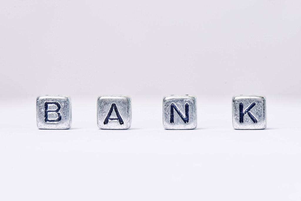 Bank word - made of miniature letter blocks on white background