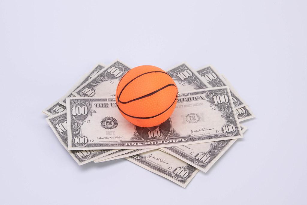 Basketball ball on US dollar banknotes