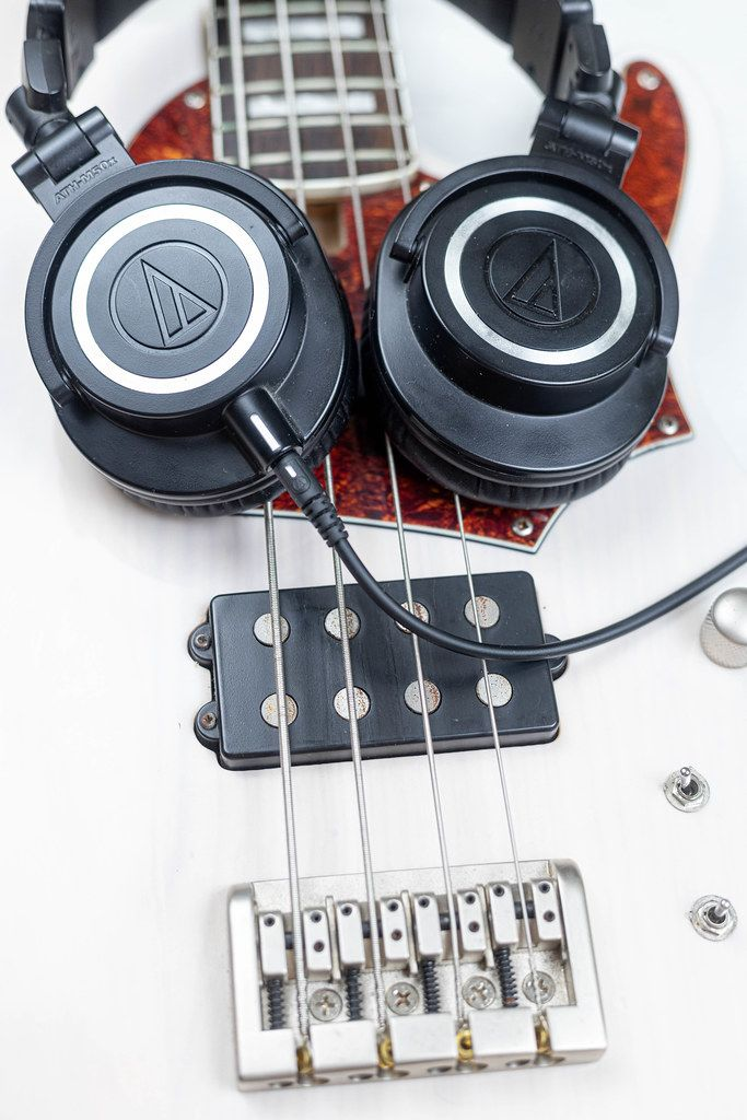 Bass Guitar Bridge with Studio Headphones on the guitar