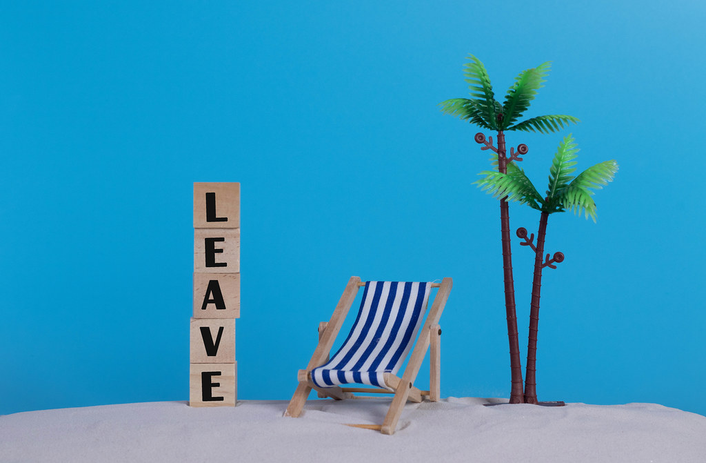 Beach chair and wooden blocks with Leave text