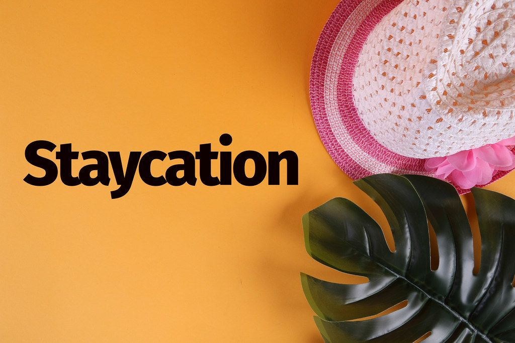 Beach hat with tropical monstera leaf and Staycation text