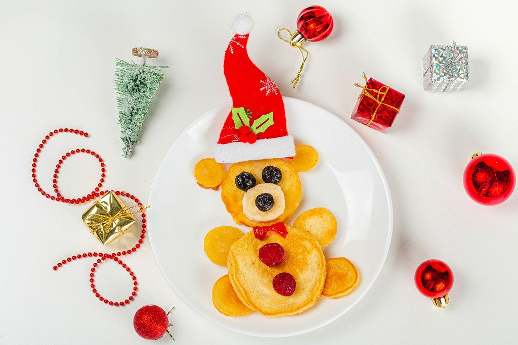 Bear pancakes with christmas decor, top view