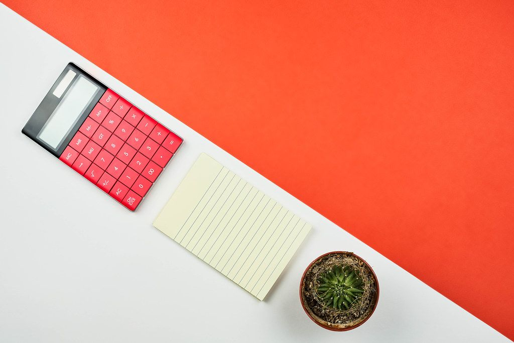 Beautiful arrangement of office supplies on bright split-colored background